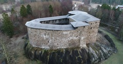 Cinema 4k aerial moving away from Raseborg medieval castle, fortress ruins,.. Stock Footage
