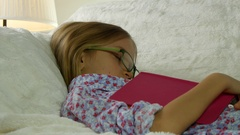 4K Sleeping Eyeglasses Child after Studying, Reading, Schoolgirl Napping on Sofa Stock Footage