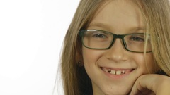 Eyeglasses Child Portrait Smiling, Happy Laughing Girl Face Closeup White Screen Stock Footage