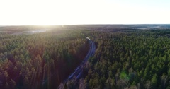 Cinema 4k aerial view of a snowy railroad track , in a autumn day, in a for.. Stock Footage