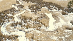 Aerial view of small mountain creek  in the Winter. Stock Footage