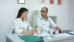 Medical personnel chatting while having coffee break Stock Footage
