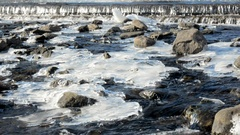 River rapids with rocks and icy patches Stock Footage