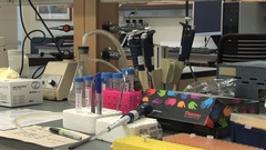 Research lab bench beakers pipettes micro tube racks Stock Footage
