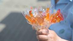 Senior adult woman selling homemade lollipops Stock Footage