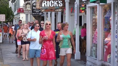 Tourists Walk Past Stores in Downtown Key West, Florida Stock Footage