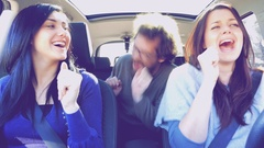 Three happy people in car driving dancing and singing like crazy retro styl.. Stock Footage