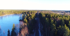Cinema 4k aerial view of a flight above a snowy railroad track, between a i.. Stock Footage