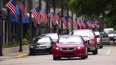 Busy Street in Fort Lauderdale with Traffic and American Flags Stock Footage