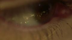 Macro of female eye with beautiful make up looking away Stock Footage