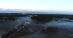 Cinema 4k aerial view of flying above a foggy field, at a spooky sunset, at.. Stock Footage