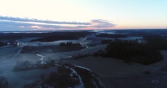 Cinema 4k aerial view of flying above a foggy field, at a spooky sunset, ev.. Stock Footage