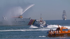 Coast Guard speeding through harbor at Navy Marine Day Stock Footage