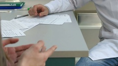 Woman's hands paying money for pills prescribed by doctor Stock Footage