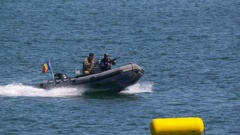 Navy Seals train on rubber zodiac watercraft at Navy Marine Day Stock Footage
