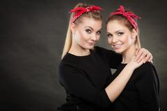 Loving sisters in retro pin up stylization. Stock Photos