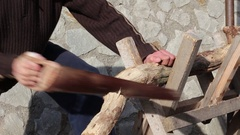 Man sawing wood, using a handsaw Stock Footage