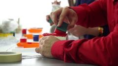 Hand of designer making sponge pattern on a ceramic mug. Creative Workshop. Stock Footage