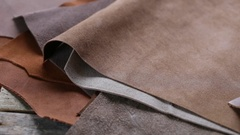 Brown and beige leather on the  wooden table Stock Footage