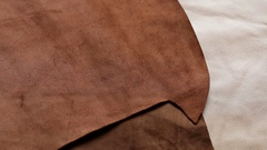 Female hands neatly folded pieces of  brown leather Stock Footage