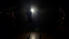 Sexy girl spinning around a pole in a dark room in slow motion. Pole dance. Stock Footage