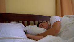 Young Man Overslept for Work Stock Footage