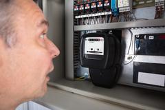 Shocked Man Looking At Meter Stock Photos