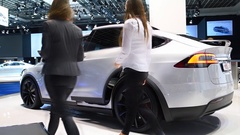 Tesla Model X all electric, luxury, crossover SUV car with two women Stock Footage