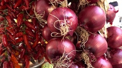 Red onions and chilies at the vegetable market Stock Footage