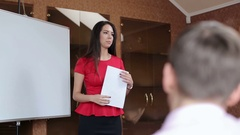 Young businesswoman giving presentation to colleagues in board room. Stock Footage