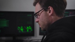Close up of hacker using his gadget to match password and gain unauthorized Stock Footage