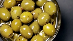 Olives in olive oil Stock Footage