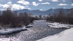 Beautiful Picturesque Rocky Mountain River Scene in Winter Snow Stock Footage