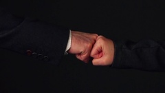 Businessman and businesswoman fist bumping in office Stock Footage