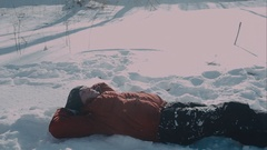 Cute young hipster couple having fun in winter park on a bright day hugging each Stock Footage