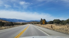 Car window view of snowy mountains, driving on route 395, on a sunny novemb.. Stock Footage
