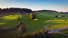 Beautiful fields green grass meadows countryside wide landscape sunny blue sky Stock Footage