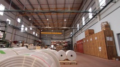 Massive rolls of plastic in a factory Stock Footage