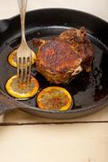 Pork chop seared on iron skillet Stock Photos