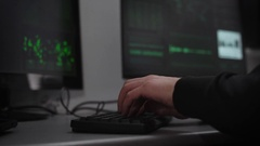 A hacker is preparing for cyber-attack in the underground computer room. A man Stock Footage