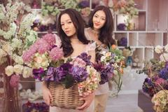 Beautiful asian women florists happy working in flower store with a lot of Stock Photos