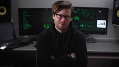 Hacker villain malicious eyes looking when the camera moves on him, against the Stock Footage