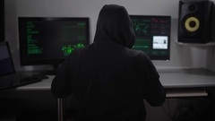 Portrait of spiteful hooded hacker downloading important data file from network Stock Footage