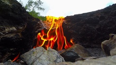 Rare natural phenomenon, a gas flame from the rock for the backdrop Stock Footage