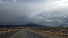 Driving on route 93, towards a storm, near jackpot town, on a november day,.. Stock Footage