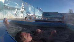Couple relaxing in outdoor geothermal spa having balneological properties Stock Footage
