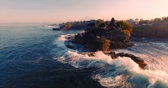 Tanah Lot Temple on the rock in Sea. Ancient hinduism place of worship Stock Footage