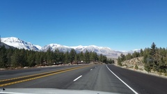 Driving view of a sunny november day, autumn colors and snowy mountains on .. Stock Footage