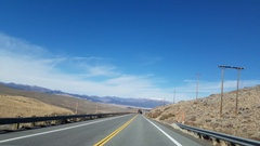 Driving view on a sunny november day, autumn colors and snowy mountains on .. Stock Footage