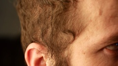 Close the eyes of a young white man with curly hair plan. He blinks and moves Stock Footage